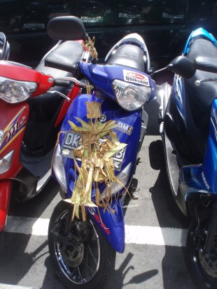 Motor bike with offerings