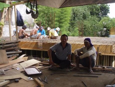 Workmen fixing the metal frame on my floor