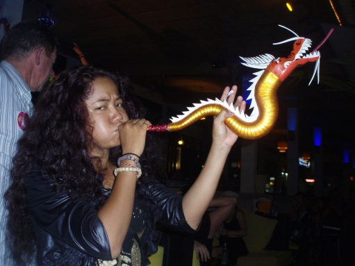 Katie - blowing her trumpet - dragon style