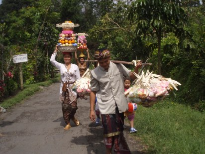 Ketut and his family on the way to the ceremony