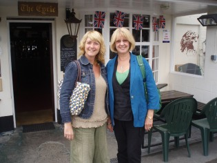 Linda and I at a countryside pub - with British flags on the window supporting the Olympics