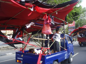Giant kite attached to the vehicle by a bamboo frame