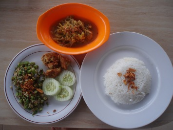 Lawar, fish sate (without the stick), ares (banana trunk vegetable) and rice