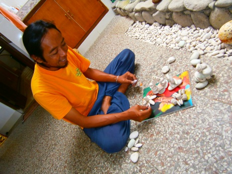Yaniq making light artwork of pebbles