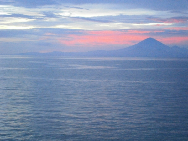 View across the ocean to Mount Agung, Bali